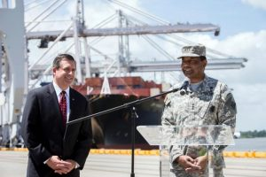 Georgia Ports Authority Executive Director Curtis Foltz, left, and Lt. General Thomas Bostick, commander of the U.S. Army Corps of Engineers, give an update on the Savannah Harbor Expansion Project as cranes work a vessel, Thursday, May 28, 2015, at the Garden City Terminal near Savannah, Ga. The harbor deepening, currently in the construction phase, will deepen the shipping channel from 42 to 47 feet at mean low water.