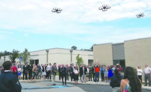 Students of the new class fly smaller drones over the crowd during Friday's launch of Putnam County High School's Unmanned Aircraft Systems Pathway.