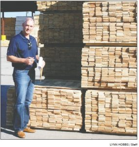 Universal Forest Products of Eatonton General Manager of Operations Jason Settles inventories wood outside the local plant.