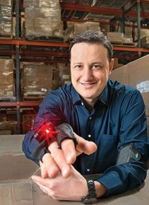 High-tech Warehousing: Ayal Latz, president and founder of a2b Fulfillment, demonstrating a wearable bar-code scanner
