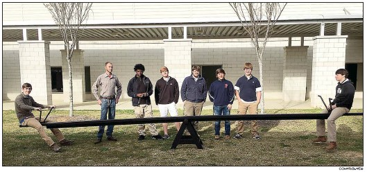 Putnam County High School welding students showing off a see saw they made for the PCHS campus include, from left, Clinton Lea, Aaron Clark, Clinton Clemons, Brandon Marshall, Tyler Deloach, Douglas Gordon, David Sides and Brandon Price.